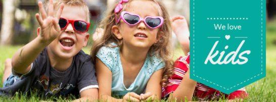 Happy little kids in cute sunglasses